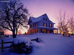 Old Victorian home during Christmas time in New England.  All hues of purple sunset.