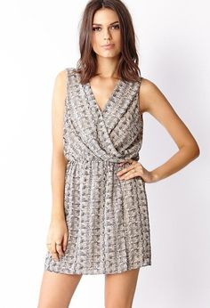 Love 21 - A woven dress featuring a surplice front opening and abstract print. Sleeveless. Elasti...