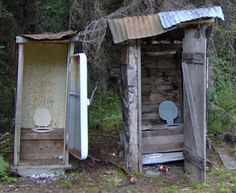 Two Holer Mining outhouses Seats up for Men. The Donovan Creek Mines Company High Class Privy Facilities. A Two holer and a one Holer.