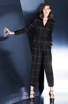 Escada - Fall/Winter 2014-2015 Business blazer in our captivating window check design with a distinctive shawl collar. The classic three-button blazer features an elaborate drawstring detail at the waist and an elegant peplum detail at the back, which emphasize the feminine silhouette.
