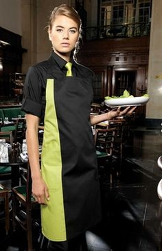 A classic full bib apron with a contrast coloured panel appearing along the length of the right hand side. The colours used on this apron form part of the 'Colours' collection from Premier, so the customer can be assured of an exact colour match in unifor Cafe Uniform, Waiter Uniform, Hotel Uniform, Restaurant Aprons, Restaurant Uniforms, Chef Dress, Women Wearing Ties, Waitress Apron, Apron Designs