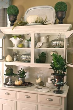 My hutch from #Goodwill dressed in Milk Glass, silver and a touch of green for the fall season.  #thrift #decor #home