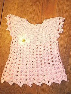 A sweet, not-to-lacy frock to dress up the new baby girl in your life.