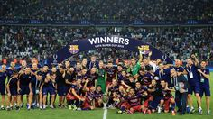 Barcelona players celebrate after winning the UEFA Super Cup trophy at the end of their UEFA Super Cup against Sevilla