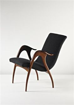 MALATESTA AND MASON Armchair, c. 1960  Leather, walnut. 78 cm. (30 3/4 in.) high Manufactured by Malatesta and Mason, Italy.