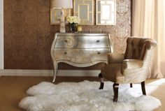repaint a piece of furniture with shimmery paint. This chest from Horchow complements the chic space.