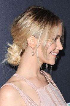 Jennifer Lawrence, casually making a loosely plaited, low bun at the nape of the neck the most coveted hairstyle going