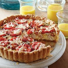 Kentucky Hot Brown Tart (turkey, cheddar, chives, bacon, eggs, salt, freshly ground pepper, pie crusts, and freshly grated parmesan.)