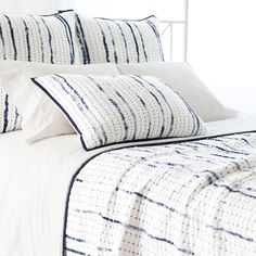Inspired by traditional Indian kantha quilts, this silky-soft cotton voile quilt features textured, speckled indigo stripes, contrast kantha stitching, and indigo banding on a plush white backdrop. Mix and match with other shades of blue, or let this quilt pop against juicy brights like persimmon, citrus, and fuchsia. • 100% cotton voile; 100% cotton batting. • Kantha stitched. • Solid indigo band/hem on all sides.
