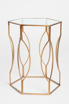 "URBAN OUTFITTERS | Hexagon Side Table $99 |  SKU # 26732586 | Sculpted metal side table in an elegant geometric shape with a glass tabletop. Makes a nice nightstand, too! | 19""l, 19""w, 24""h 