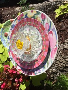 Pink tulips, daisies and a cute pink and green plaid plate with a yellow rose center. MiMi's Plate Flowers