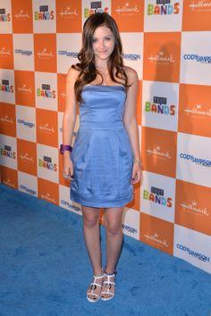 Rachel G. Fox's Blue Dress smiling