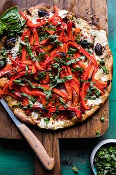Mediterranean Roasted Red Pepper Pizza | halfbakedharvest.com @hbharvest via @hbharvest