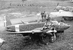 The Italians posing on the bomber Fiat CR 25. In the background seems shrouded sticking out the nose SM 79 Sparviero. Pin by Paolo Marzioli