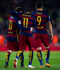 Neymar Santos Jr of FC Barcelona is congratulated by his teammates Luis Suarez and Lionel Messi after scoring his team's fifth goal during the La Liga match between FC Barcelona and Sporting Gijon at Camp Nou on April 23, 2016 in Barcelona