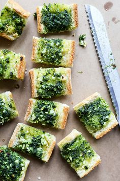 A crispy crust, a soft interior and a heavy slathering of butter and garlic is a guaranteed recipe for success. Read more at http://ohmyveggies.com/vegan-garlic-bread-with-kale-pesto/