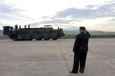 U.S.-North Korea Tension -  North Korean leader Kim Jong Un guides the launch of a Hwasong-12 missile in this undated photo released by North Korea's Korean Central News Agency (KCNA) on September 16, 2017.
