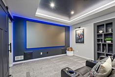 This basement remodel is all about the natural light! It features a custom built home theater, wet bar and dining room, entertainment space, fireplace, home gym, full bathroom. Check out that custom made concession stand? Finished Basement Company, Living Area, Living Spaces, At Home Movie Theater, Custom Built Homes, Wet Bars, Basement Remodeling, Natural Light, Dining Room