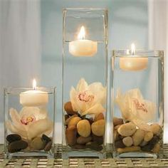 Diy. Dollar store Mason Jars, fake flowers, floating candles,  and stones or marbles.