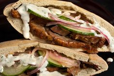 Dear God this looks delicious!   Lamb Pitas with Cucumbers and Yogurt Sauce