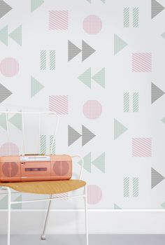 Back to the 1980s with a super-sized graphic design based on the function buttons of tape cassette players.52cm x 10m ROLL 106mm REPEAT - HALF DROP Wallpaper may not always come off the r...