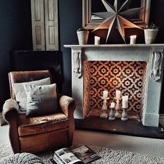 [orginial_title] – Veronica Terrazas House: Adding Hygge to the Living Room A vintage leather armchair beside a marble fireplace with Bert & May encaustic patterned tiles in grey and white in this hygge living room Dark Living Rooms, Living Room With Fireplace, Living Room Chairs, Home Living Room, Living Room Designs, Living Room Decor, Empty Fireplace Ideas, Bert And May Tiles, Fireplace Tile Surround