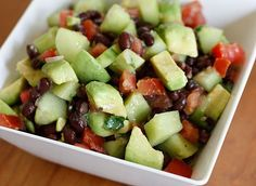 "Combine - 2 medium tomatoes, 2 peeled and chopped cucumbers, 2 chopped avocados, 1/2 chopped red onion, 1 can of drained and rinsed black beans, 2 tbsp. chopped cilantro (optional), juice of 1 lime, 1 tsp. cumin, and salt and pepper to taste.  Toss in a bowl and serve alone as a side dish, on top of greens for a salad, or as a ""relish"" on chicken or fish."