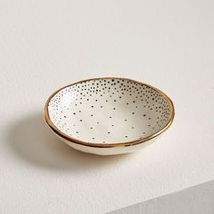 Each piece in Louisa Podlich's collection starts as a tiny ball of clay and is shaped and decorated by hand, a mano. The A MANO Dotted Ceramic Trinket Dish comes in white with a black polka dot print + gold trim and is the perfect spot fo West Elm, Decorative Accessories, Decorative Items, Decorative Bowls, Diy Clay, Clay Crafts, Clay Projects, Keramik Design, Deco Originale