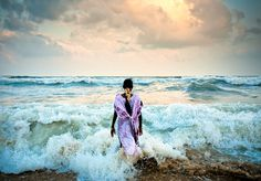 """Photography by Kirk Mastin """"I followed this girl out into the water during Pongal, the Tamil New Year festival. She was one of thousands if not millions, that day on Chennai's Marine Beach, the second longest in the world. On the third and final day of the festival, families throng to the beaches, irrespective of socio-economic class. She was having a personal moment away from the crowds and was unaware of me."""" - Kirk via Nuru Project (nuruproject.org)"""