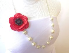 Could make the flower out of sheer fabric for a prettier result.  Red Poppy Flower Necklace, Red Flower necklace, Flower Necklace, Bridesmaid Necklace, Summer Necklace. $25.00, via Etsy.
