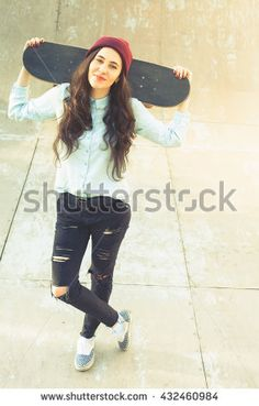 Awesome skateboarder girl with skateboard outdoor at skatepark. Skatebord at city, street. Cool, Funny Tenager. Half-pipe. Skateboarding at Summer. School, schoolgirl