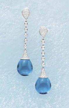 Margherita Burgener, A Pair of Diamond and Blue Topaz Earpendants Each pavé-set diamond pear-shaped bombé surmount, suspending a series of circular-cut diamond collets terminating in a cabochon blue topaz drop,  mounted in 18K white gold