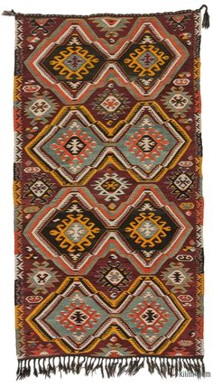 Vintage Turkish tribal kilim rug handwoven in 1960's in the Mut region of the Taurus Mountains by the Taurus Yoruks who are migratory people of Central Asian origin. This bautiful rug is in very good condition. The weavings of these Yoruks are strong in design and substance, as befits the lifestyle of their makers. Tight slitweave is used, so that the designs do not contain any long vertical slits; this, together with the thick warps and wefts, results in a substantial and hardwearing…