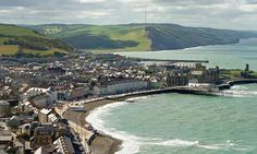 Sweeping bays, a castle, a cliff railway, gaily coloured cottages… Aberystwyth has everything you could want in a seaside town, says Tom Dyckhoff Wales Map, Where Do I Go, Aberystwyth, Lets Move, Greater London, Seaside Towns, Places Of Interest, The Guardian, Great Britain