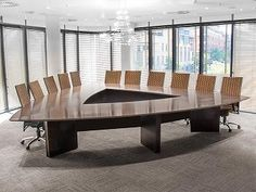 Triangular boardroom table with custom made chairs in weave fabric