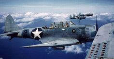 SBD Dauntless dive-bombers in flight 1942-43. Note the dive brakes seen in the foreground.