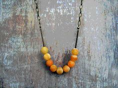Love the background for shooting jewelry. Frosted Crab Agate Necklace  Orange by JullMade on Etsy, €25.00