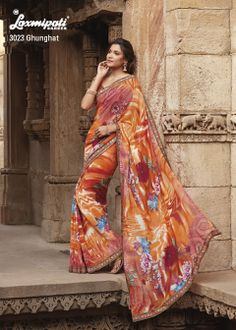 Multiple flower printed on a orange colored Georgette saree & embroidery  lace work, Bravo !