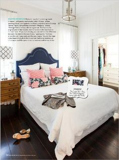 Homes: Into the light. Pink and navy form a marriage made in heaven, with pretty cushions by Caitlin Wilson Textiles creating a focal point against a bedhead covered in James Dunlop 'Kismet' fabric. Lampshades covered in Westbury Textiles 'Trelliage' fabric in Navy add extra glamour. The floor is the original pine timber boards, stained to match the new floor in the extension. - clipped from page 68 of Home Beautiful, Mar 2014 issue by the Netpage app.