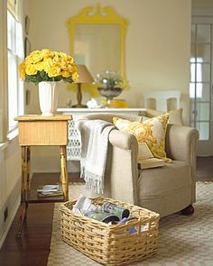 chrome-yellow Chippendale-style mirror frame, creamy yellows in the chair pillow's print; and the meltingly pale, new-minted gold of full-blown roses. Inspiring yellow details include notions, fabrics, and trimmings in silk, cotton, and rayon
