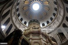 The tomb of Jesus Christ with the rotunda is seen in the Church of the Holy Sepulchre on March 21 2017 in Jerusalem Israel The tomb of Jesus Christ... Jesus Tomb, Jesus Christ, Terra Santa, Stock Pictures, Stock Photos, Holy Land, Royalty Free Photos, Explore, Architecture