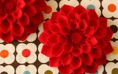 Here's a great tutorial from a couple of years ago for a felt dahlia flower brooch by Megan Reardon (at Holidash).