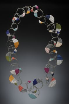 Wire & polymer necklace by JM Syron & Bonnie Bishoff. Would be interesting with fabric or half circle weavings.