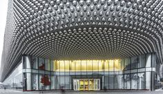 Clad in illuminated stainless steel spheres reminiscent of disco balls, the Hanjie Wanda Square in Wuhan City telegraphs its luxury status.