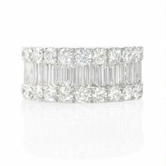 NEW: Wide diamond 18k white gold band featuring 29 baguette diamonds surrounded by 26 round brilliant cut white diamonds 3.35ctw.