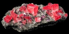 Rhodochrosite with purple Fluorite on needle Quartz
