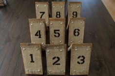 Wood & Burlap Rustic Country Wedding Table Numbers. $12.00, via Etsy.