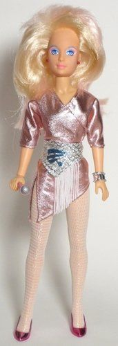 I had a Jem doll.  She was bigger than Barbie, so they couldn't share clothes.  But Ken could wear them!  Yeah, I totally had a transvestite Ken doll.