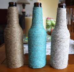 bottles wrapped in yarn make pretty flower vases