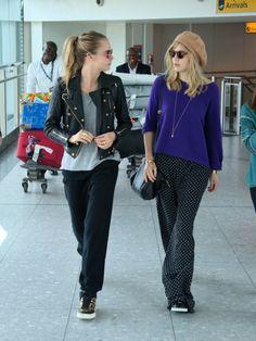 carah0lic:  Cara Delevingne with Suki Waterhouse arrive at Heathrow Airport, London - 26/04/2014